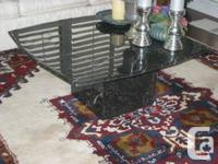This gorgeous square black marble coffee table was