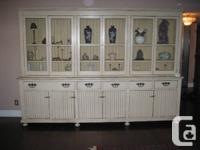 This big Armoire  has beige antique look and is