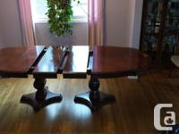 Hello, I'm a lovely Dining room table with not one but