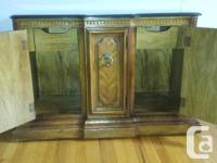 Solid wood cabinet with marble top. on wheels for easy