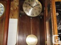 THIS IS A SPING WIND PENDULUM CLOCK. ONE FULL WIND