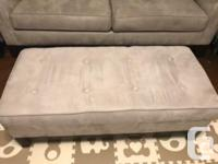 Well loved sofa, chair and ottoman set. High quality