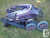An older very safe still Evenflo Six Wheeler Buggy , in
