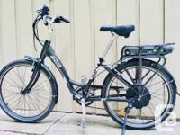 Lightly used electric bike with step-through frame.