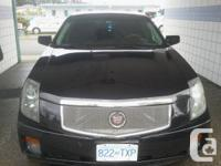This Ad is for a mint condition cadillac CTS 4 door