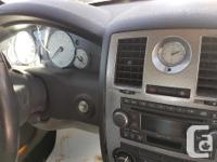 Make Chrysler Colour Grey Trans Automatic kms 1980000