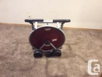 """Ab roller with knee pads, 26"""" in circumference, stands"""