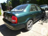 Make Mazda Model Protege Year 2003 Colour Green
