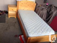 This is a very good condition twin size bed Pine frame