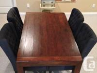My husband and I acquired this reclaimed timber table a