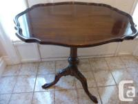 I am offering an outstanding antique tilt top table