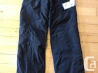 Black, water immune snowboard or ski trousers. Women's