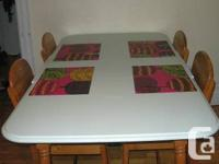 """Charming """"country style"""" dining table with 4 chairs."""
