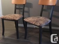 Dining Table and 6 chairs. Top of table is damaged and