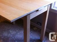 Exceptional Extendable Table.  Dining table with 2