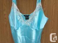 never worn, very nice Camisole with white sequins mini