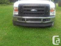 Selling a white 2008 Ford F-250 Super Duty with an