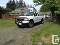 Make Ford Year 2000 Colour White Trans Automatic 7700