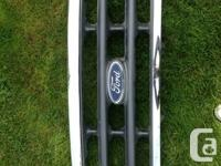 Ford grill. Fits 99 - 04 f350 trucks. Asking $100. Call