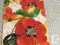 This lovely vibrant wall hanging, or table runner by