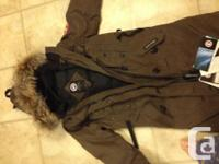 New fake canada goose coat size is xtra small but fits