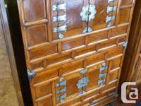 Oriental cupboard c/w four doors & 4 cabinets. An