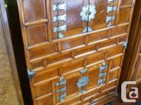 Oriental cabinet c/w four doors & four cabinets. A
