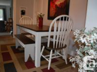 Farmhouse table complete with 2 chairs and 2 wooden