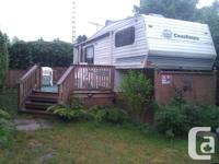 Located in quiet family park, on private cedar tree