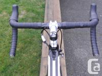 Aero frame with multipositional seatpost for use as a
