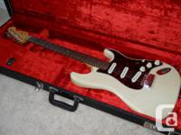 American Deluxe Strat in white blonde finish. Comes