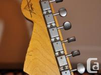 This is a truly awesome Strat in perfect condition.