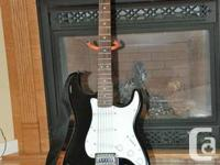 Fender electric guitar, includes Fender Frontman 10G
