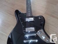 I'm offering my Fender Jaguar Baritone. It's a very