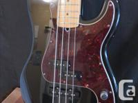 Year 2000 - American made Fender P/J Bass. Two nicks on