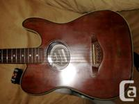 This burgundy Fender Squier Electro Acoustic Telecaster