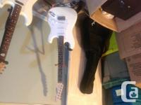White Fender Starcaster student guitar (electric) looks