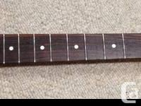 This is a Fender Stratocaster neck.  Not sure where it