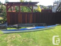 Fiberglass 17 ft., ocean kayak, colour blue and white
