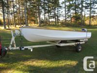 . Tidy 16 foot fiberglass boat as well as trailer,