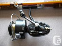 Three fiberglass fishing rods, each with a Mitchell 300
