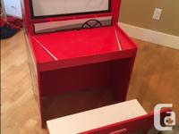 This is a great kids' desk with toy storage on the back
