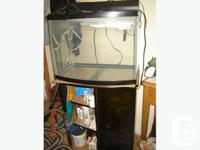 Have a 32 gallon fish tank with stand. Includes
