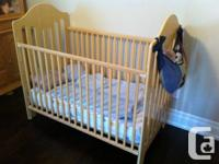 Clean, simple, strong.  Made by Fisher-Price.  Crib and