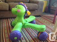 Babies first walker and riding toy. As they walk along