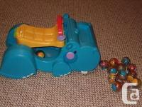 fisher price gobble n go hippo ride along push