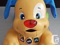 Fisher-Price Laugh & Learn Stride to Ride Puppy Dog