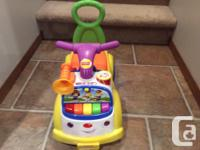 Fisher Price Musical Marching ride on walker in
