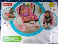 Brand new never opened fisher price swing. It has