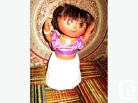 Product Features Dora comes dresses and performs two